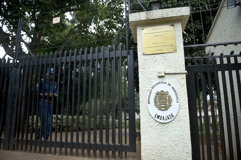 <p>A security guard from a private company walks on July 27, 2012 near the gate the of the Venezuelan embassy residence in a Nairobi suburb. Venezuela's acting ambassador, Olga Fonseca, was found strangled at her Nairobi home, Kenyan police said.</p>