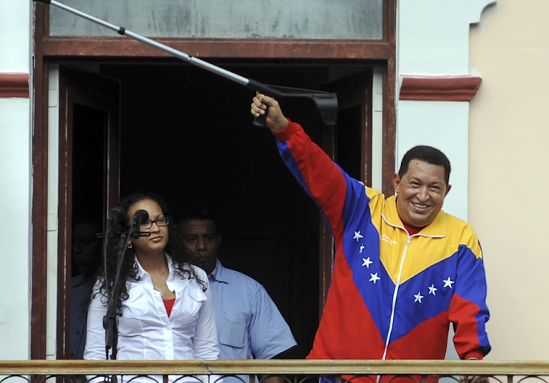 """<p>Venezuelan President Hugo Chavez raises a crutch after his weekly program """"Alo Presidente,"""" in Caracas, on May 22, 2011. There is growing concern about Chavez's health two weeks after he underwent surgery in Cuba for what authorities said was a pelvic abscess.</p>"""
