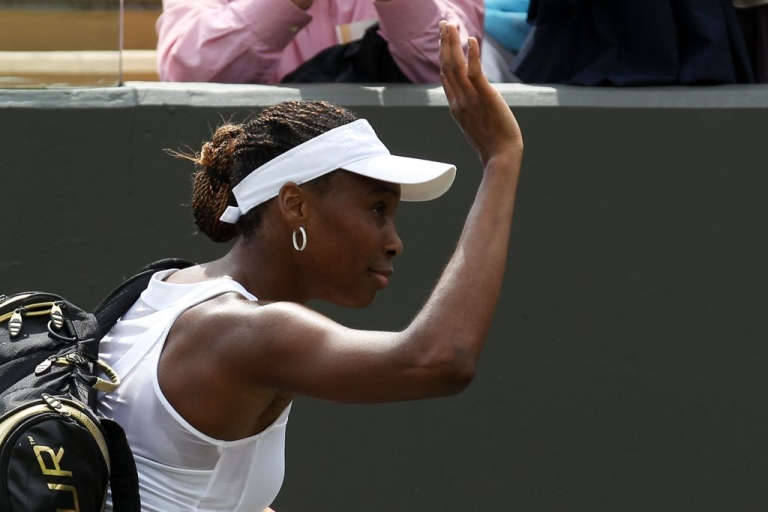 <p>Venus Williams waves goodbye to the crowd after crashing out of Wimbledon on day one.</p>
