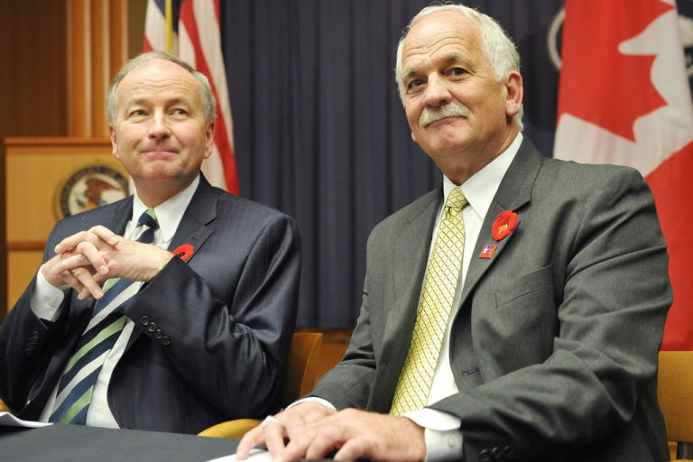 <p>Canada's Minister of Justice Rob Nicholson, left, and Public Safety Minister Vic Toews attend the 2010 Cross-Border Crime Forum in Washington, DC. A leaked document says Toews told Canada's spy agency it can share information with foreign governments even if that intel leads to torture.</p>