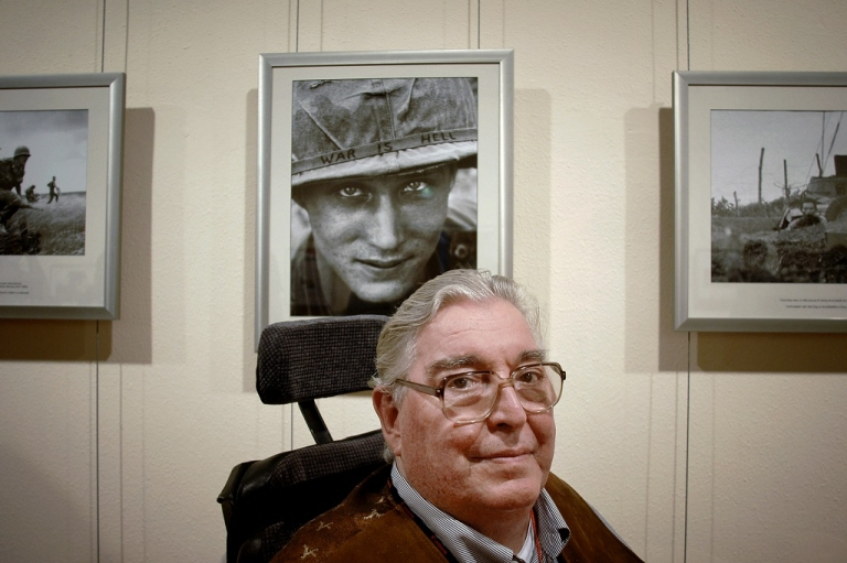 <p>Legendary war photojournalist and two-time Pulitzer Prize-winner, Horst Faas, poses in front of his images at the International Festival of Photojournalism in Perpignan, France in Sept. 05, 2008. His daughter, Clare Faas, confirmed her father died on May 10, 2012 at the age of 79.</p>