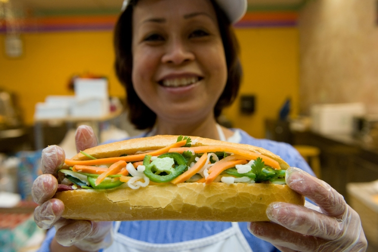 <p>Kathy Nguyen holds up a banh mi sandwich she made at Banh Mi DC in Falls Church, Va., Oct. 16, 2009. The Vietnamese sandwiches have become a growing fad in the United States.</p>