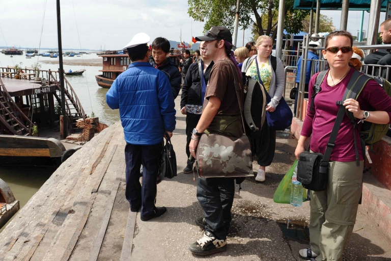 <p>Foreign tourists prepare to board a tourist boat for a tour on Halong Bay in northern Vietnam on Feb. 17, 2011. Twelve people, most of them foreign tourists, died when their tour boat suddenly sank while they slept in Halong Bay, one of Vietnam's top tourist destinations, officials said.</p>