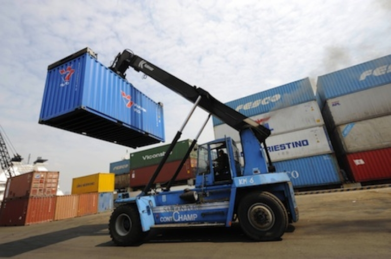<p>A forklift removes a container at Saigon Port in Ho Chi Minh City on March 6, 2008.</p>