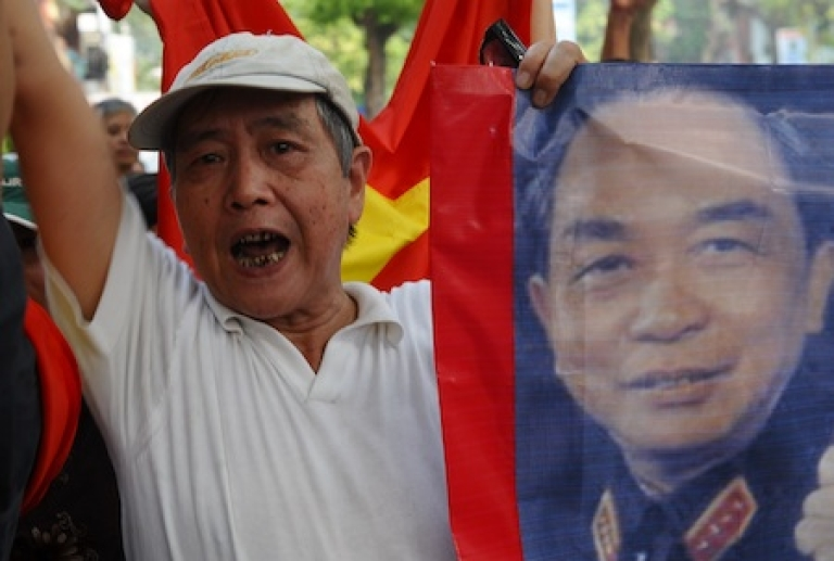 <p>A Vietnamese protestor shouts anti-China slogans on a street close to the Chinese embassy in Hanoi on July 17, 2011. About 50 people, including some of the country's well known intellectuals, have staged anti-China protests over an escalating maritime dispute with China in the South China Sea. The rally was quickly dispersed by police after a dozen protestors were arrested. An unprecedented series of protests -- which are not common in authoritarian Vietnam -- have taken place peacefully in Hanoi.</p>
