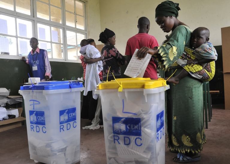 <p>A Congolese woman casts her ballot in Goma during presidential and legislative elections on November 28, 2011. The Democratic Republic of Congo held national elections under a cloud of violence after clashes on the final day of campaigning left at least two people died.</p>