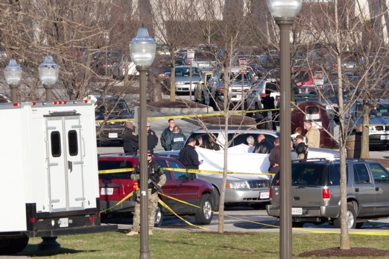 <p>Police officers gather around the scene of a shooting in front of Cassell Coliseum on the Virginia Tech campus December 8, 2011 in Blacksburg, Virginia.</p>