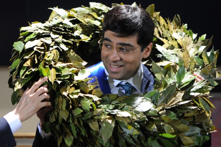 <p>India's defending world chess champion Viswanathan Anand is garlanded in the award ceremony of the FIDE world chess championship match in Tretyakov Gallery in Moscow on May 31, 2012.</p>