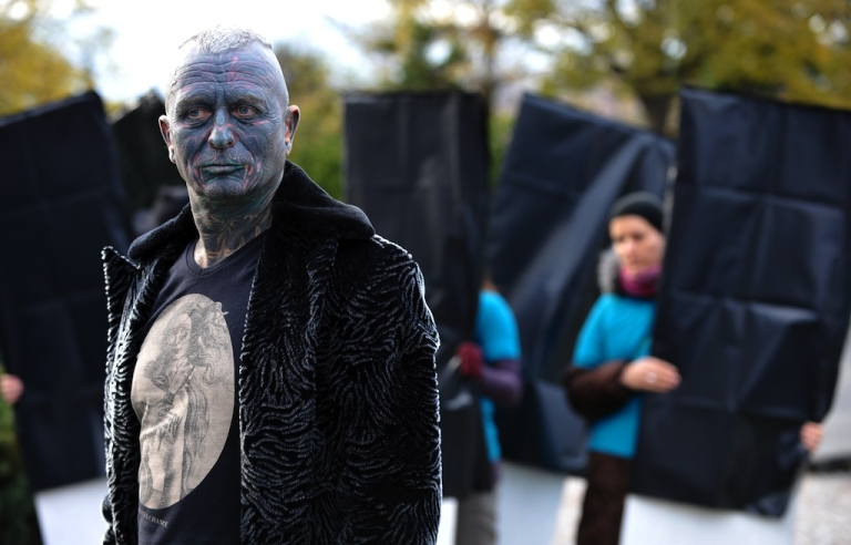 <p>Czech fully-tattooed artist and drama professor Vladimir Franz poses for a picture during his campaign for the Czech presidential elections 2013 on November 5, 2012, in Prague, Czech Republic.</p>