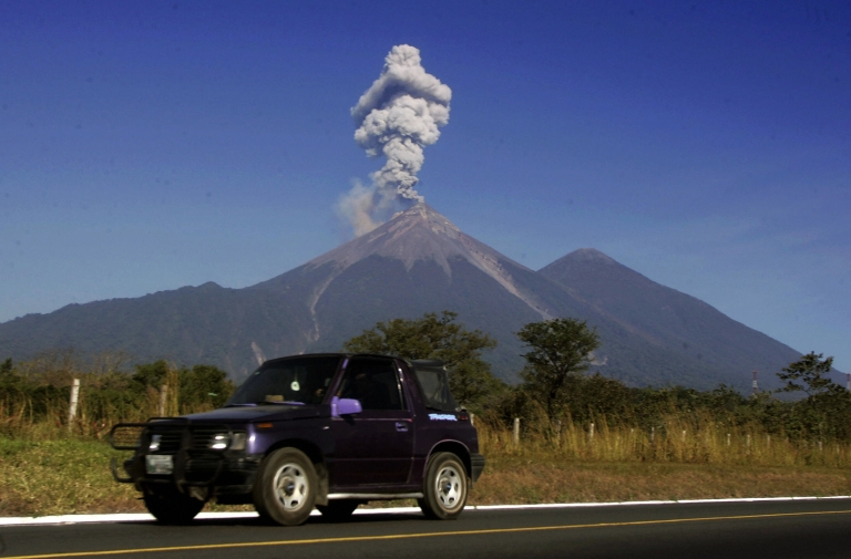 <p>A car near the Volcan de Fuego, located 3,763m above sea level on the Escuintla-Sacatepequez border, some 60km from Guatemala City, on Dec. 25, 2007.</p>