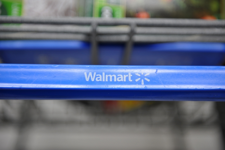<p>A shopping cart at a Wal-Mart store in Los Angeles in seen in November, 2009.</p>