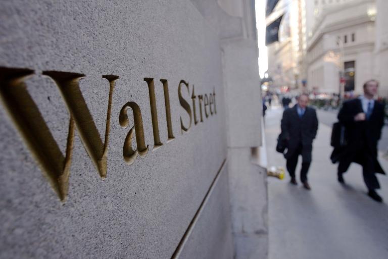 <p>Pedestrians on Wall Street in New York City.</p>