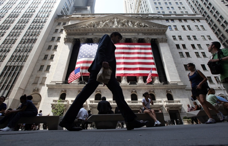 <p>People walk past the New York Stock Exchange during afternoon trading on August 4, 2011 in New York City.</p>