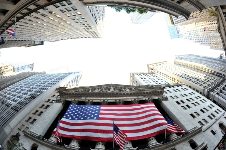 <p>A large American flag draped across the front of the New York Stock Exchange August 5, 2011.</p>