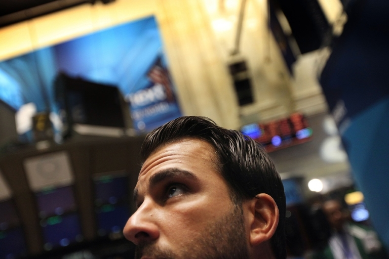 <p>Traders on the floor of the New York Stock Exchange on Aug. 10, 2011.</p>