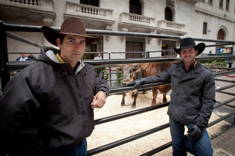 <p>In this handout photo provided by NYSE Euronext, Silvano Alves (L), 2011 the PBR World Champion, bull rider, and Douglas Duncan, a bull rider with professional Bull Riders Inc., visit the NYSE. They helped ring the closing bell on Jan 5, 2012 in New York City.</p>