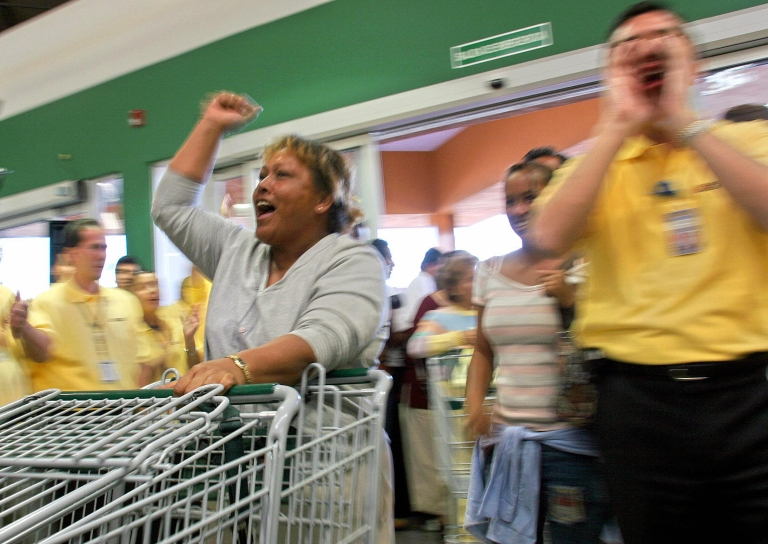 <p>Residents of the Mexican town of San Juan Teotihuacan, cheer the opening of 'Bodega Aurrera', a subsidiary of the US chain Wal-Mart, in November 2004. After months of controversy, Bodega Aurrera, opened its doors less than two miles from the archaeological site of Teotihuacan.</p>