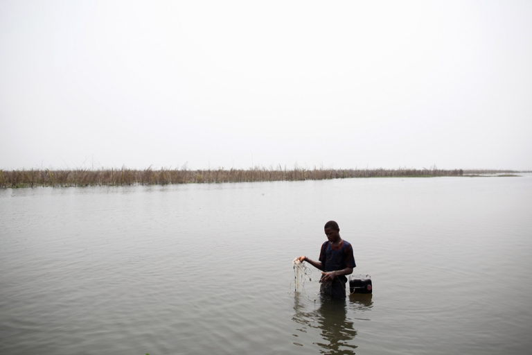 <p>A boy fishes with a net in the lagoon in Ganvie, near Cotonou, Benin. Leaders at the World Water Forum in Marseilles warned that radical policy changes need to be made in order to stem a water scarcity crisis.</p>