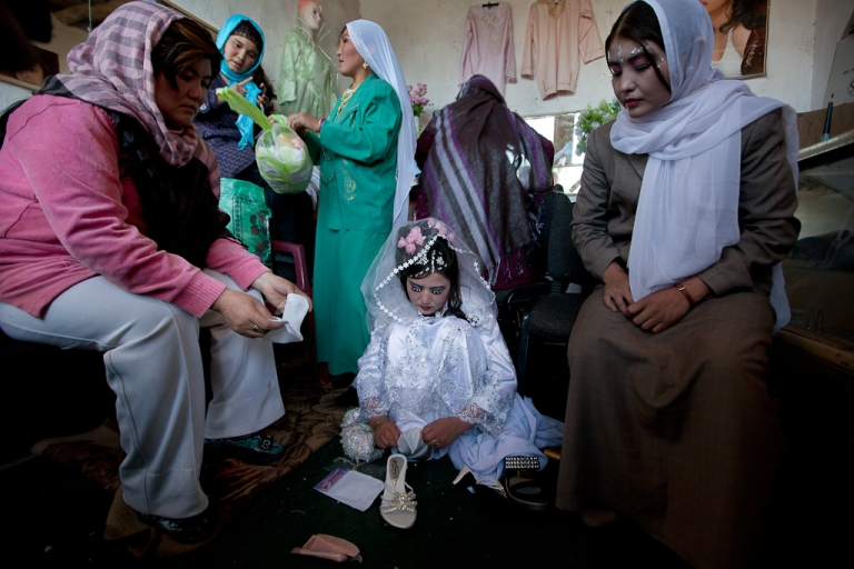 <p>Afghan bride Zahara,  24, gets ready for a wedding ceremony surrounded by female family members at a local beauty parlor in Bamiyan, Afghanistan. Oct. 14, 2010.</p>