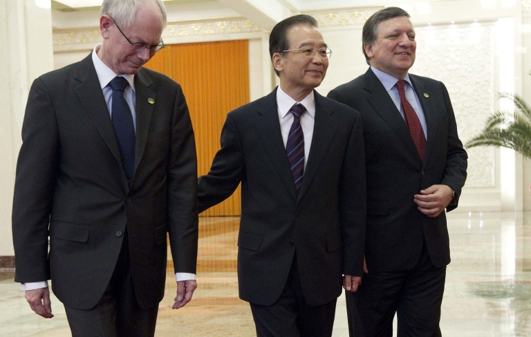 <p>European Commission President José Manuel Barroso (R), looks on as European Council President Herman Van Rompuy (L) and Chinese Premier Wen Jiabao talk at the Great Hall of the People during the EU-China summit on February 14 in Beijing.</p>