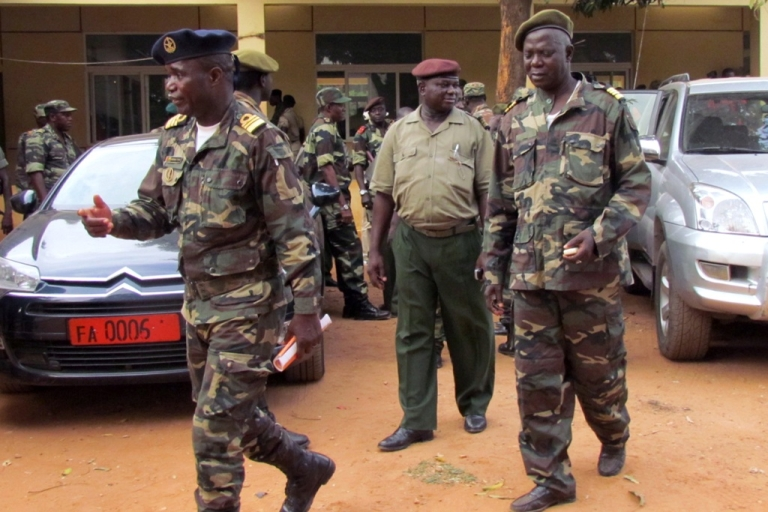 <p>Military soldiers of Guinea-Bissau on April 13, 2012 after a meeting in the capital, Bissau. Opposition parties in Guinea-Bissau were to meet on April 14, 2012 to form out a unity government after a military coup derailed presidential elections.</p>