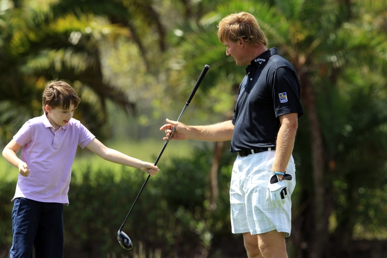 <p>Ernie Els of South Africa with his son Ben who suffers from autism during the Els for Autism Pro-am at the PGA National Golf Club in West Palm Beach, Fla., on Mar. 12, 2012.</p>