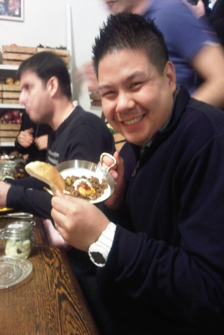 <p>White House Executive Sous Chef Tommy Kurpradit holds a plate of hummus with meat. Behind him is Kremlin Executive Chef Jerome Rigaud.</p>