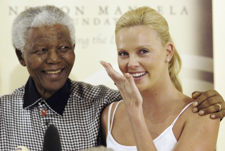 <p>Oscar winning Actress Charlize Theron wipes away tears as she meets former South African President Nelson Mandela at Mandela House following her Academy Awards success, on March 11, 2004 in Johannesburg, South Africa.</p>