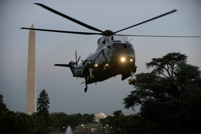 <p>US President Barack Obama arrives onboard Marine One on the South Lawn of the White House May 11, 2012 in Washington, D.C.</p>
