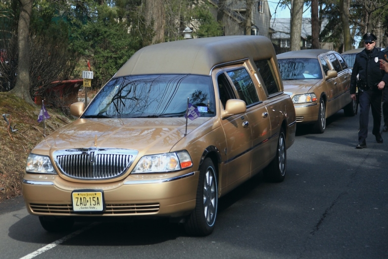 <p>The hearse carrying the body of singer Whitney Houston arrives for her burial service at the Fairview Cemetery on February 19, 2012 in Westfield, New Jersey. Whitney Houston was found dead in her hotel room at The Beverly Hilton hotel on February 11, 2012.</p>