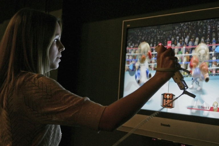 <p>A woman uses a wireless controller to play a boxing game on a Nintendo Wii during the Game On exhibition at the Science Museum on November 29, 2006 in London, England.</p>