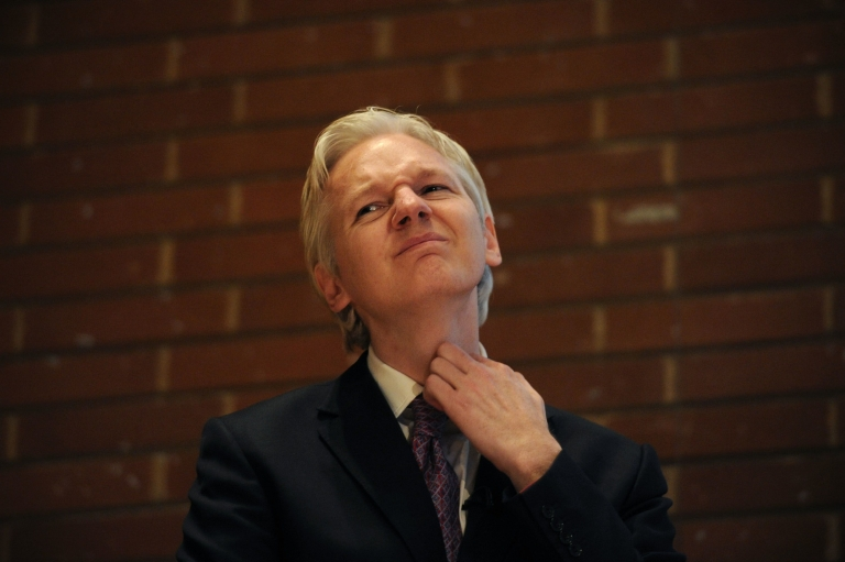 <p>WikiLeaks founder Julian Assange attends a debate on the subject of whistle-blowing with prominent public figures on secrecy and transparency issues at Kensington Town hall in central London on April 9, 2011.</p>