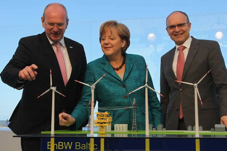 <p>Germany vowed to focus on renewable energies like wind power instead of nuclear power, especially after the Fukishima disaster.  Angela Merkel is seen here in May 2011 with a model of Germany's first offshore windfarm in the Baltic Sea.</p>