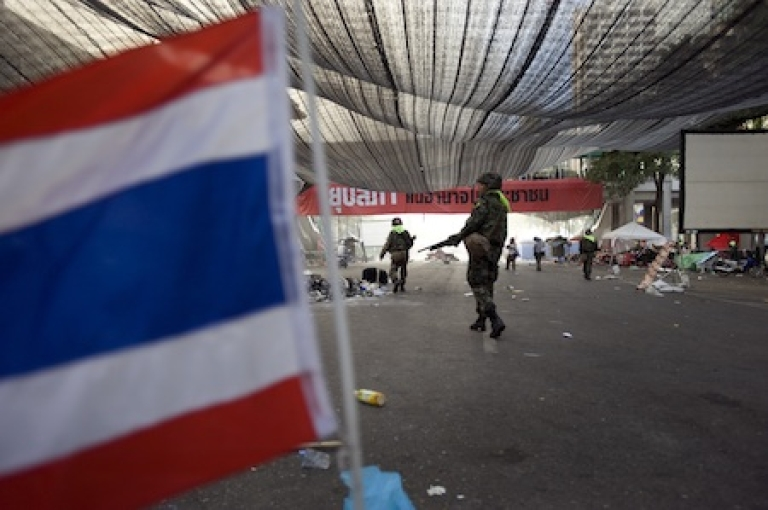 <p>Thai soldiers clear out anti-government protesters' core Bangkok encampment in May 2010.</p>