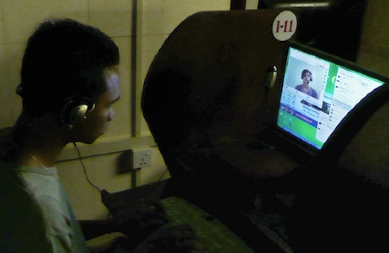 <p>This picture taken on August 23, 2010 shows a Myanmar (Burmese) man chatting online at an Internet cafe in Yangon.</p>