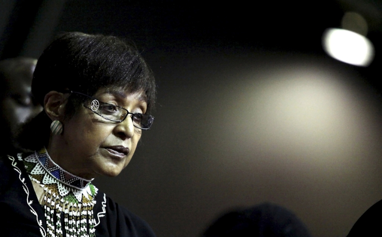 <p>Winnie Madikizela Mandela, the former wife of South African former President Nelson Mandela looks on during the funeral of anti apartheid stalwart and Women's Rights activist Fatima Meer at Durban's Exhibition Centre on March 13, 2010.</p>
