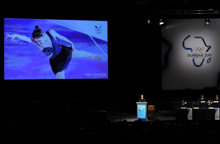<p>Olympic figure skating champion Yuna Kim adresses dignitaries during the Pyeongchang 2018 bid presentacion at the 123rd IOC session on July 6, 2011 in Durban, South Africa.</p>