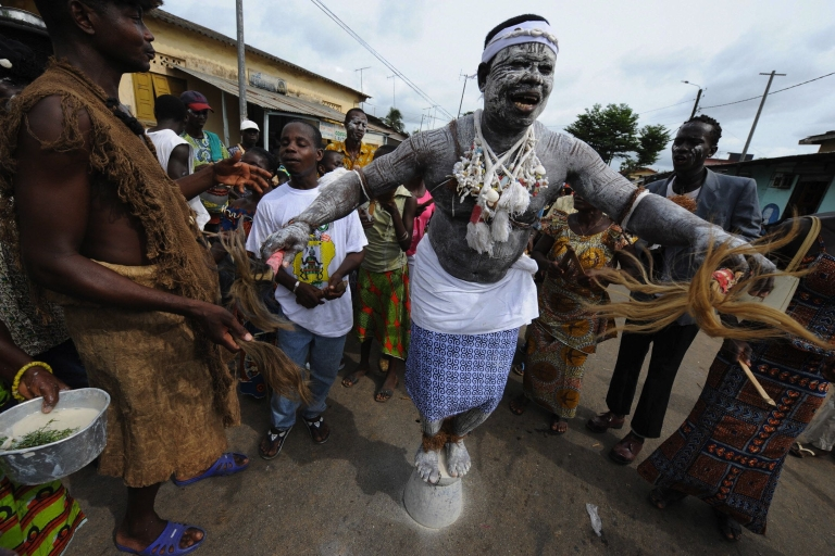 <p>A witch-doctor stands on a pot on May 3, 2008 during the procession of the 30th Popo carnival of Bonoua, south of Abidjan.</p>
