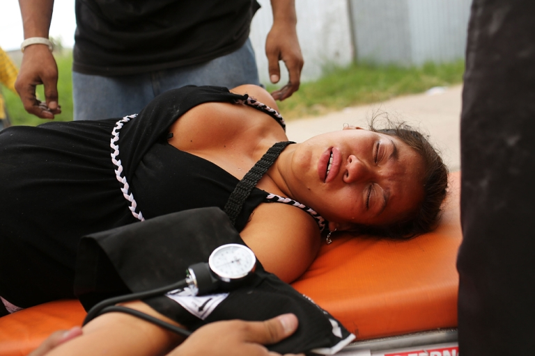 <p>A woman is comforted after fainting while her home and neighborhood are forcefully dismantled in a shanty town after the government claimed that the settlement was illegal on July 20, 2012 in Tegucigalpa, Honduras.</p>