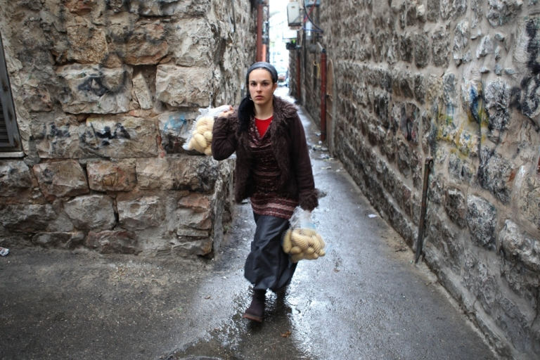 <p>A Jewish Israeli woman carries her shopping in Jerusalem on Nov. 16, 2011. Women's rights in Israel, and their role in public, is being challenged by ultra-Orthodox Jews.</p>