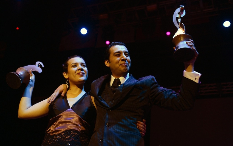<p>Argentina's Facundo de la Cruz Gomez Palavecino and Paola Sanz hold their trophies after winning the Salon Tango category on August 27, 2012 at the Tango World Championship in Buenos Aires.</p>