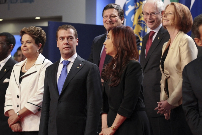 <p>Dmitry Medvedev, Russia's president, speaks with Cristina Fernandez de Kirchner, Argentina's president, before the family photograph at the Group of 20 (G20) Cannes Summit at the Palais des Festivals on November 3, 2011 in Cannes, France.</p>