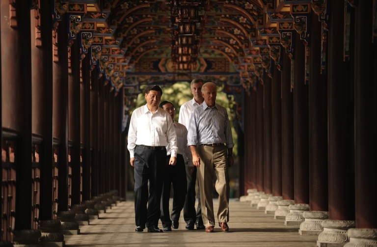 <p>US Vice President Joe Biden (R) and Chinese Vice President Xi Jinping (L) accompanied by their translators walk across the Dujiangyan Irrigation system in Dujiangyan outside Chengdu in China's southwest province of Sichuan on August 21, 2011. Biden said that the world's biggest economy has never defaulted on its debt and never would, during a visit aimed at boosting Chinese confidence in the US economy.</p>