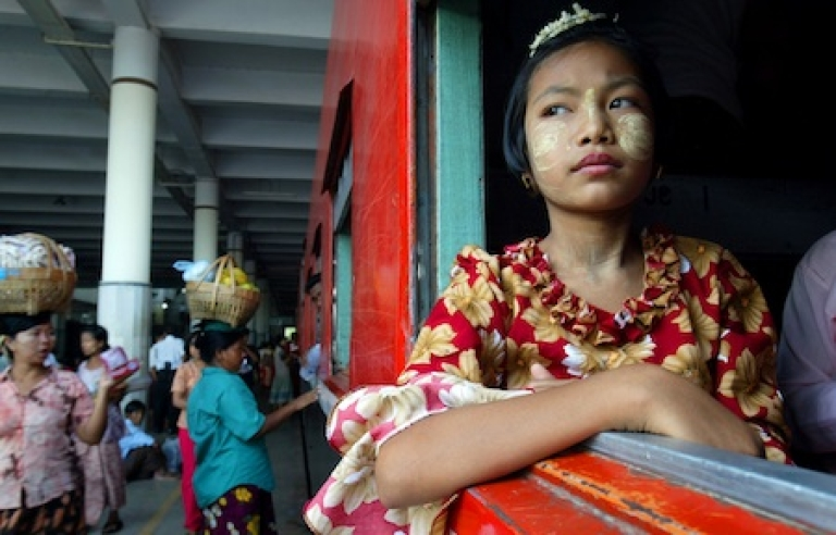 <p>A Burmese girl looks out the window waiting for an overnight train to leave the Mandalay train station in Myanmar.</p>