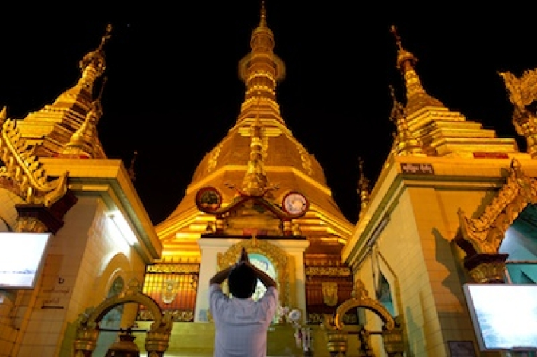 <p>A man prays at Sule Pagoda in downtown Yangon, Myanmar's commercial capital, on Feb. 16, 2012.</p>