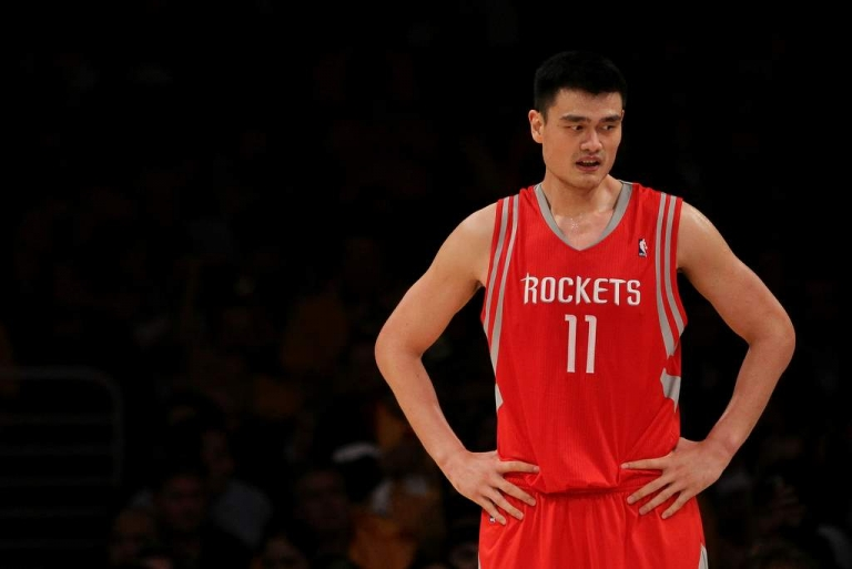 <p>Yao Ming of the Houston Rockets looks on during their opening night game against the Los Angeles Lakers at Staples Center on October 26, 2010 in Los Angeles, California.</p>