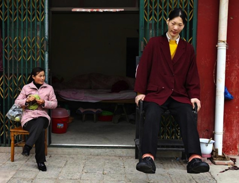 <p>Yao Defen and a friend sit at the entrance of her home in China's eastern province of Anhui.</p>