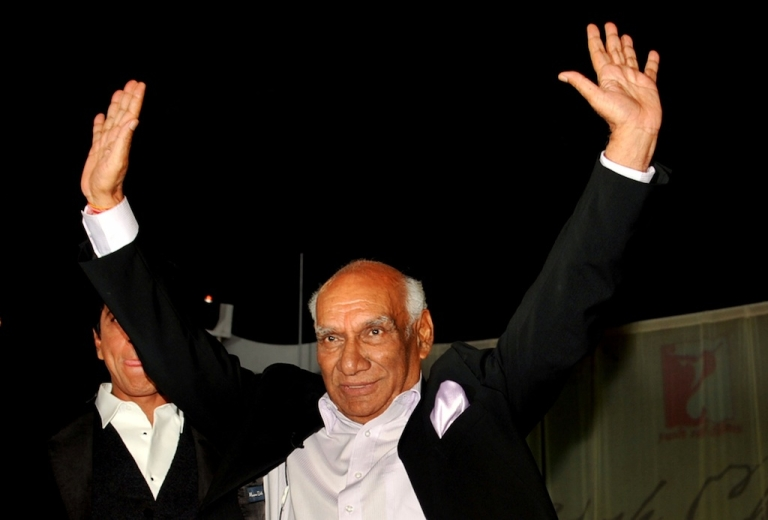 <p>In this photograph taken on September 27, 2012 Indian Veteran Bollywood filmmaker, director, screenwriter and producer Yash Raj Chopra celebrates his birthday at a film promotion in Mumbai. Renowned Indian film director Yash Chopra died in hospital aged 80 on October 21, 2012 after suffering dengue fever, his production company said, ending a decades-long career of flamboyant Bollywood blockbusters.</p>