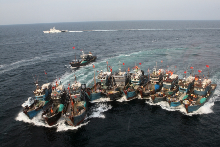 <p>Chinese boats banded together with ropes, chased by a coastguard helicopter and rubber boats, after alleged illegal fishing in South Korean waters in the Yellow Sea. Nov. 16, 2011.</p>