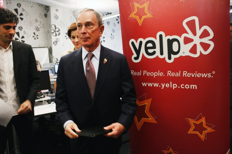 <p>New York Mayor Michael Bloomberg visits the new East Coast headquarters of the online review company Yelp on October 26, 2011 in New York City.</p>